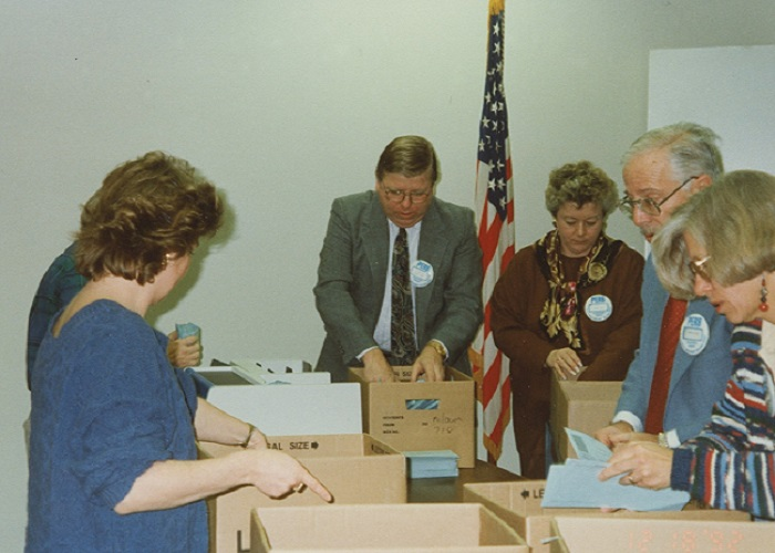 PERB staff, SUNY officials, and union representatives open and tally ballots for an election among graduate assistants and teaching assistants
